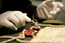 reading a manuscript in an archive